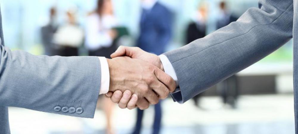 shaking hands with Konica Minolta partner